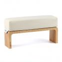 White hand cushion with wooden base